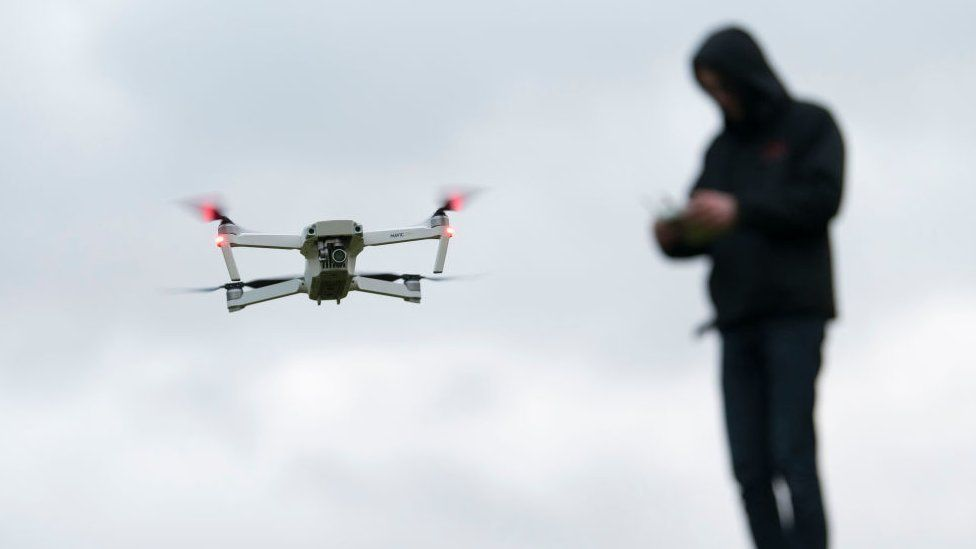 Drones, or Unmanned Aerial Vehicles (UAVs), can be controlled remotely and film footage